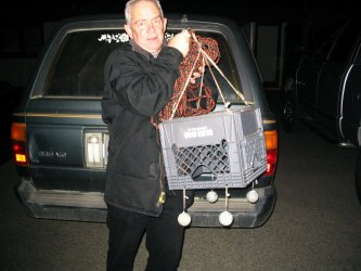 Kevin McGrath uses a weighted milk crate to lower rockfish suffering from barotrauma