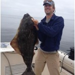 HASA president Scott McBain hoists a Pacific Halibut